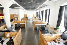 LETTER FOUR's office in Downtown Los Angeles. We have a great loft-style space with an open floor plan, concrete floors, OSB desks, and barn doors.