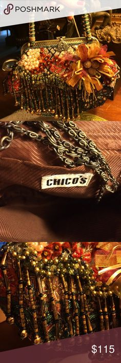 Chico's Stunning Embellished Handbag This bag has hanging beads, a beautiful flower & is beaded all over. Front & back are identical. It has a shoulder chain. Looks like a Mary Frances bag Chico's Bags Shoulder Bags