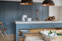 A classic shaker kitchen with our trademark industrial twist. Farrow & Ball's Down Pipe paint looks great against the reclaimed scaffold plank floor. We used the dark end of the room to house a bank of spacious larder cabinets and kept the rest of the room clear of high level cupboards which creates a wonderful …
