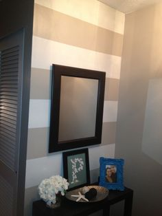 Striped accent wall in entryway