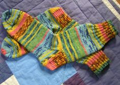 "i made several pairs of these!  yay for opal yarn.  (hundertwasser ""kuss im regen"")"