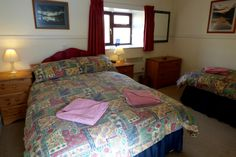 Glenlivet Cottage - one of 3 bedrooms with a double and single bed
