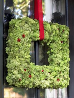 How to Make a Christmas Moss Wreath  Bring unexpected shape and organic texture to your outdoor entryway during the holidays with a square moss wreath embellished with faux cranberries and ribbon. http://www.hgtv.com/handmade/how-to-make-a-christmas-moss-wreath/index.html