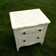 """A thrifty find made over with chalk paint and a custom stencil with the definition of """"home""""."""