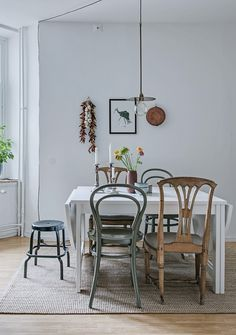 Scandinavian styled kitchen with different chairs.