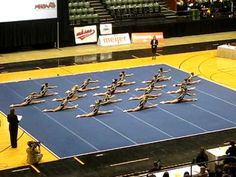 State Champs 2010 cheer! Love how sharp their motions are! Full-squad back tucks isn't too bad either.