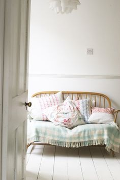 Lovely Pastel fabric pillows in a entry/receiving area