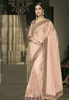 #Peachish #Pink #Fancy #Georgette And #Net #Saree With #Blouse.  Peachish Pink Fancy Georgette And Net Saree designed with Zari,Resham Embroidery With Stone Work And Lace Border.   INR: 3,135.00  With Exclusive Discounts  Grab:http://tinyurl.com/h2ayqud
