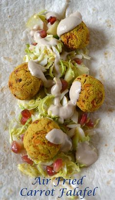 Air Frier Carrot Falafel with Tahini Sauce and salad. Easy, Delicious, Vegan and gluten free. Can be baked or roasted in a conventional oven.