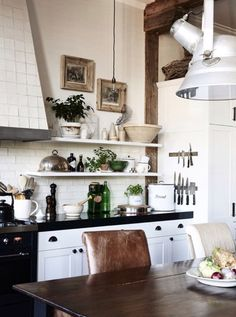 Black and white kitchen with open shelving.