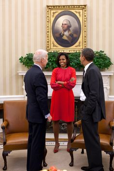 President Obama and Vice President Biden talk with First Lady Michelle Obama in the Oval Office, Nov. 21, 2011 (Photo by Pete Souza)
