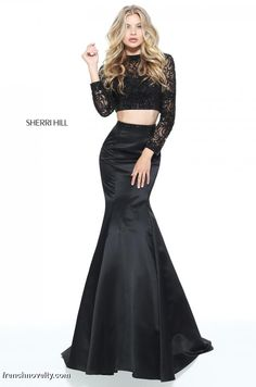 Sherri Hill 51107 is a 2-piece prom dress with a long sleeved, beaded crop top and a satin mermaid skirt.