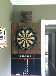 Dartboard made from a pallet and outdoor light.