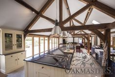 A long kitchen diner space with an oak open vaulted ceiling featuring king post trusses Long Kitchen, Open Plan Kitchen, Barn Conversion Interiors, Knock Down Wall, Roof Truss Design, Small American Kitchens, Oak Frame House, British Architecture, Contemporary Barn