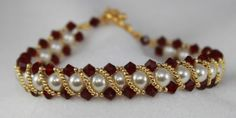 Pretty!  Looks to be RAW with pearls and bicones and embellished with gold seed beads.