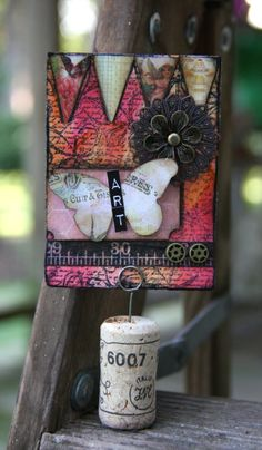 Iris Garden: artsy atc- dried marigold, rusty hinge and worn lipstick