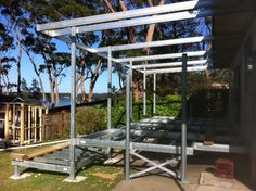 Boxspan steel deck frame with pergola on the NSW South Coast. This frame was installed by an owner builder to add an outdoor entertaining area to their holiday home. Timber decking will we installed over the steel frame and the awning beams painted.