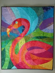 "Flamingo Quilt.. I think she seems to be looking for my ""Quiltasaurus Rex""  (from a billion years ago.... actually from AQS  annual desk calendar in maybe 1989 or 1990...   You flamingo is gorgeous..lynn graves"