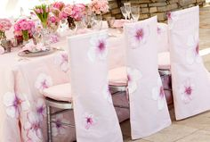 Your guests could be sitting at their seats for several hours over the course of your reception, so in addition to the watercolour menu cards, consider painted linens for your tablescapes.