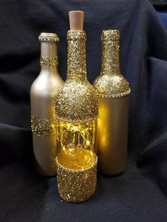 Decorated Wine Bottles 70874 A set of 3 upcycled wine bottles, 2 spray painted a. - Decorated Wine Bottles 70874 A set of 3 upcycled wine bottles, 2 spray painted a warm gold metallic - Glitter Wine Bottles, Gold Bottles, Painted Wine Bottles, Glass Bottles, Bling Bottles, Wine Glass, Glass Bottle Crafts, Wine Bottle Art, Diy Bottle