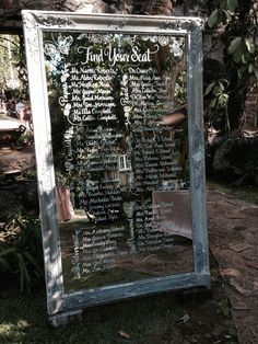 Antique Mirror used as a seating chart