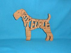 Hey, I found this really awesome Etsy listing at https://www.etsy.com/listing/73483433/airedale-dog-handmade-scroll-saw-wooden