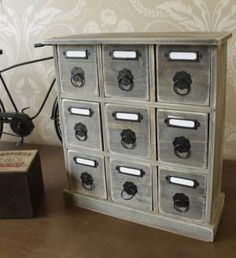 Wooden nine drawer mini chest of drawers