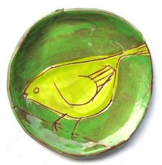 Yellow and green bird sketch hand painted plate.                                                                                                                                                                                 More