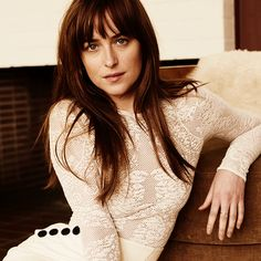 She is wearing a white crocheted long sleeved shirt with a tight white skirt that is just hugging every inch of her..