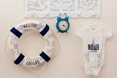 This momma hung the life preserver (with well wishes) from her baby shower and the personalized onesie (that she had the nurses at the hospital stamp the baby's footprints on) in her son's nursery. Very sweet and personal items.