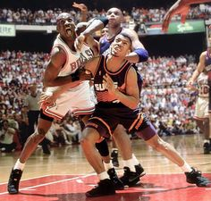 Suns guard Kevin Johnson battles with Michael Jordan for position under the basket as Charles Barkley looks on during the 1993 NBA Finals. Johnson, currently the mayor of Sacramento, is battling to build the Kings a new arena. (Walter Iooss Jr./SI)