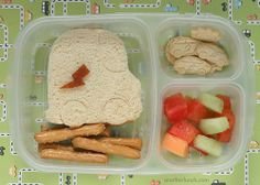 """peanut butter & blueberry preserve sandwich cut with the Lunch Punch """"Vroom!"""" car shape, some organic vanilla cookies, featuring electric cars (cute!) (from Whole Foods), whole wheat pretzel sticks,  mixed fruit,  a hand-cut lightning bolt to mirror the cookies. """"That lightening bolt was trickier for me to cut out than I'd like to admit!"""""""