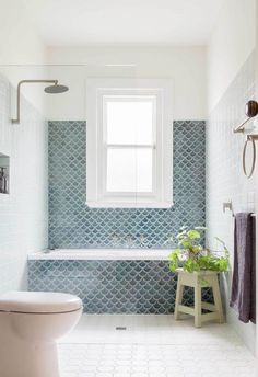 A Melbourne bungalow's eco-friendly transformation A Melbourne bungalow's eco-friendly bathroom transformation with grey blue scallop tiles. Brown Bathroom Decor, Diy Bathroom, Bathroom Fixtures, Modern Bathroom, Small Bathroom, Glass Bathroom, Beachy Bathroom Ideas, Bathroom Vinyl, Minimal Bathroom