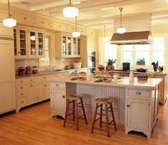 Victorian style, with beadboard and subway tile.  Double island!