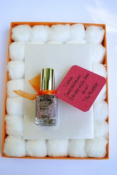 Manicure Gift Card on a bed of cotton balls...