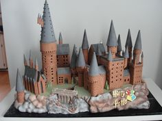 Harry Potter Hogwarts Castle Cake This is the biggest cake I've made to date. It sits on a 2 ft by 4 ft board. Consists of gingerbread...
