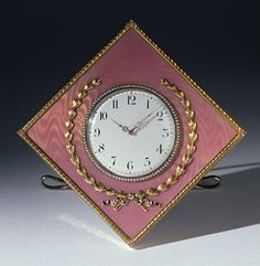 An Imperial guilloché enamelled and gold mounted clock   by Carl Fabergé