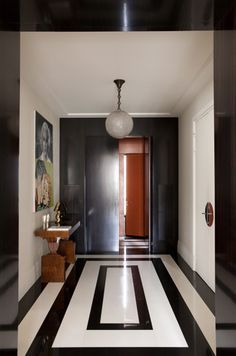 Chic, graphic black and white painted floors.