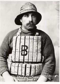 Jim Wheeler, fisherman & lifeboatman taken in studio, wearing old cork life jacket.