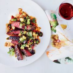 Chef Stephanie Izard serves this grilled steak recipe with a terrific summer fruit salsa spiked with lots of herbs.