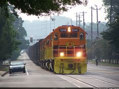 """Pic #7 Description: Another photo of the Columbus & Chattahoochee RR """"street running"""" down 9th St heading for the river Photo Date: 7/1/2012 Location: Columbus, GA Author: Ken Roble Categories: Winter Locomotives: CCHT 3348(SD40-2)"""