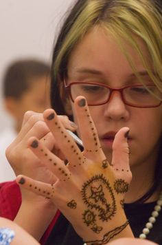 Teens learned the art of henna at the Athens-Clarke County Library on Thursday, taking an opportunity to apply the temporary body art that has been used since ancient times in the Middle East.