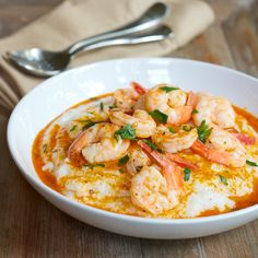 Shrimp & Grits Grits: 2/3 cup dry quick cooking grits (not instant) 2 1/2 cups water 3/4 teaspoon Kosher salt 1/2 cup milk 2 teaspoons butter Shrimp: 1 tablespoon butter 1 tablespoon olive oil 1/4 teaspoon dried oregano Pinch of red pepper flakes Juice of 1 lemon 1 to 2 tablespoons hot sauce 1/4 teaspoon Kosher salt 12 ounces medium-size shrimp, peeled & deveined