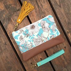 Floral canvas zipper clutch with leather bottom