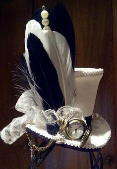 73d836fda55 Inspired Alice in Wonderland mini top hat. This color version is off white  satin with
