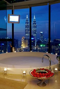 Ummm yeah. Someday I might have to have this. Strawberries, chocolate, stunning view, candles, hot bath, bubbles, AND THERE IS A TV IN FRONT OF THE TUB! These are a few of my favorite things... #dreamlife http://www.womenswatchhouse.com/