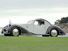 1934 Voisin C27 Aérosport (Supercars.net)   While Voisin made many unique and interesting cars based on his vast aircraft knowledge, none are as breathtakingly distinct as this C27 Aérosport built on chassis 52002. With a clever mix of French curves and Voisin's art deco touches, it is one of the most deserving cars to be labeled as rolling sculpture.