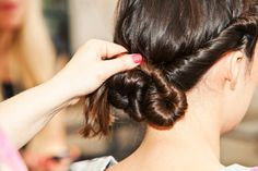 3 DIY 'Dos Perfect For Any Type Of Workout  #refinery29  http://www.refinery29.com/workout-hairstyles#slide10  Tuck the ends in and pin, using the same method for pinning as previously directed.