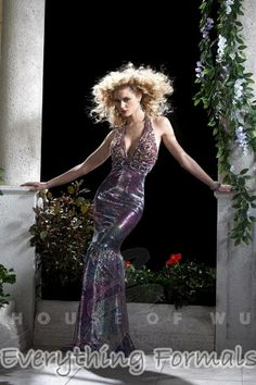 Animalistic and Daring Printed Liquid #Sequins V Neck Flare Long #PromGown by #Panoply Style 14383~ MSRP: $439.07 Guaranteed Low Price: $353.99 (You save $85.08) *This product is on SALE (http://www.everythingformals.com/Panoply-14383/)