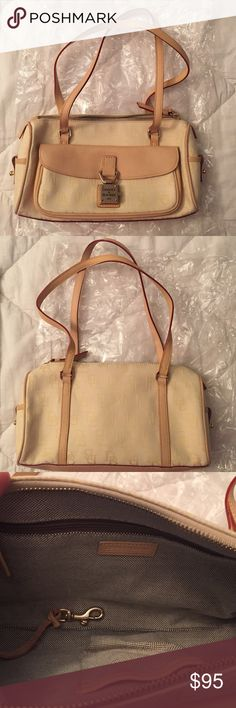 Authentic Dooney & Bourke Small Purse Cream colored with traditional DB emblem printed on the bag. Outer pocket and inside zip pocket with key ring. Great condition. No stains. Handles: 10inch drop. Bag height: almost 6inches. Bag width: 11 inches across the bottom. Dooney & Bourke Bags Shoulder Bags